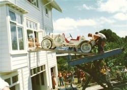Rene Dunn built this imaculate 1928 Speedster in all white in his second floor lounge, and is seen here removing it out the window..jpg