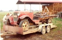 The North Island Model A Ford Club 1930 AA Bus work in progres in 1978 on display at Mirangi Bay, here being towed by Ross Ward's 1930 Tudor..jpg